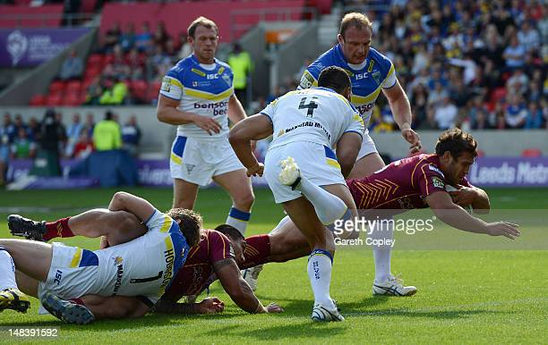 Scott Moore of Huddersfield scores the opening try during the Carnegie Challenge Cup Semi Final match between Huddersfield Giants and Warrington...