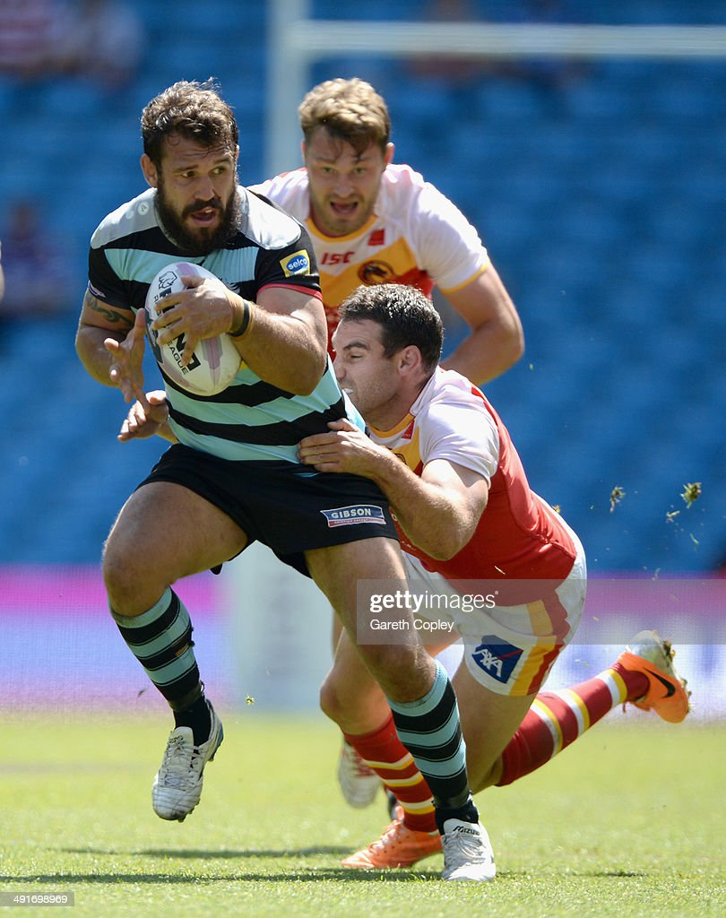 Scott Moore of London Broncos gets past Thomas Bosc of Catalan Dragons during the Super League match between London Broncos and Catalan Dragons at Etihad Stadium on May 17, 2014 in Manchester, England.