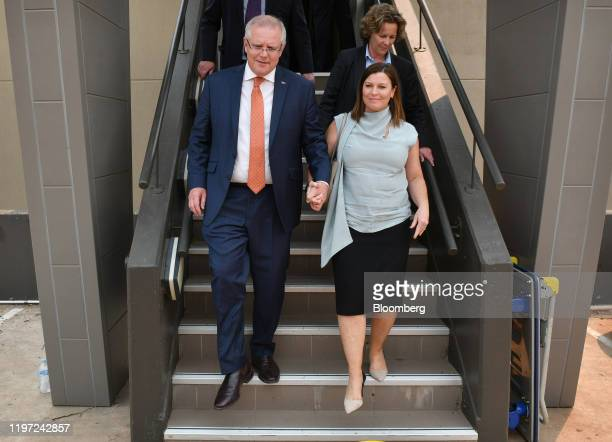 Scott Morrison Australia's prime minister left and his wife Jenny Morrison arrive at a news conference at the National Press Club in Canberra...