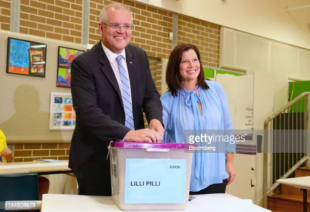Scott Morrison Australia's prime minister left poses for photographs with his wife Jenny Morrison as he casts his ballot at a polling station during...