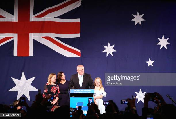 Scott Morrison Australia's prime minister second right speaks as his wife Jenny Morrison second left and their daughters Abigail left and Lily stand...