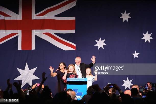 Scott Morrison Australia's prime minister second right waves with his wife Jenny Morrison left and their daughters Abigail second left and Lily on...