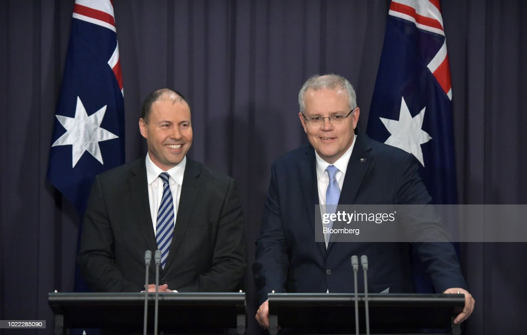 Scott Morrison, Australia's prime minister-designate and leader of the Liberal Party, right, and Josh Frydenberg, Australia's energy minister and deputy leader of the Liberal Party, attend a news conference in Canberra, Australia, on Friday, Aug. 24, 2018. Morrison pledged to bring stability once he becomes Australia's sixth prime minister in 11 years after Malcolm Turnbull relinquished power on Friday in a party coup. Photographer: Mark Graham/Bloomberg via Getty Images