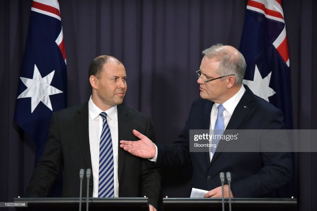 Scott Morrison, Australia's prime minister-designate and leader of the Liberal Party, right, speaks as he gestures towards Josh Frydenberg, Australia's energy minister and deputy leader of the Liberal Party, during a news conference in Canberra, Australia, on Friday, Aug. 24, 2018. Morrison pledged to bring stability once he becomes Australia's sixth prime minister in 11 years after Malcolm Turnbull relinquished power on Friday in a party coup. Photographer: Mark Graham/Bloomberg via Getty Images