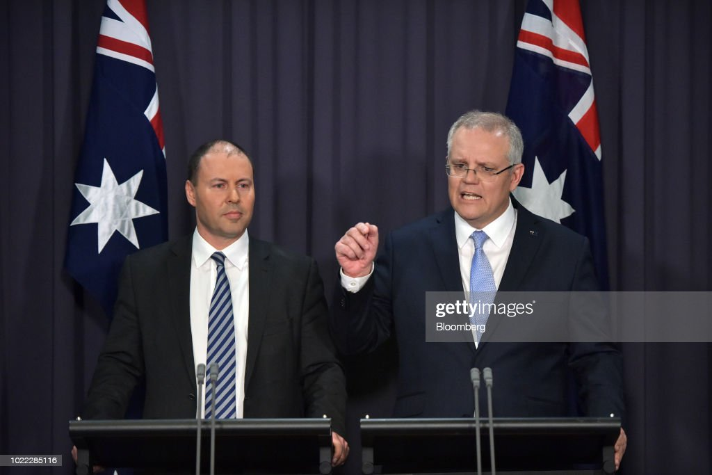 Scott Morrison, Australia's prime minister-designate and leader of the Liberal Party, right, speaks as Josh Frydenberg, Australia's energy minister and deputy leader of the Liberal Party, looks on during a news conference in Canberra, Australia, on Friday, Aug. 24, 2018. Morrison pledged to bring stability once he becomes Australia's sixth prime minister in 11 years after Malcolm Turnbull relinquished power on Friday in a party coup. Photographer: Mark Graham/Bloomberg via Getty Images