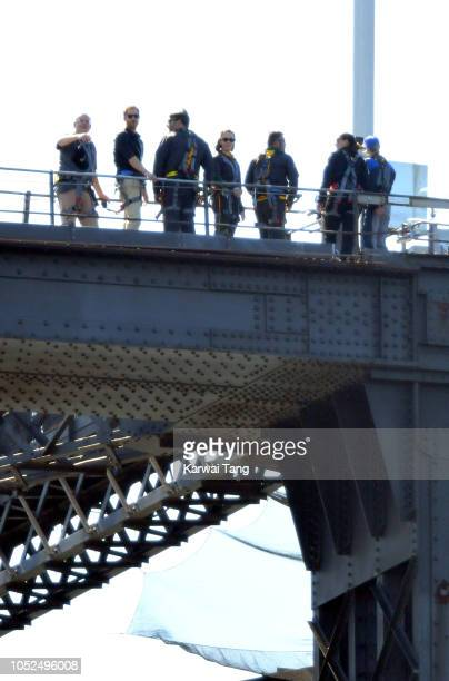 Scott Morrison MP and Prince Harry Duke of Sussex climb the Sydney Harbour Bridge to officially raise the Invictus Flag celebrating the arrival of...