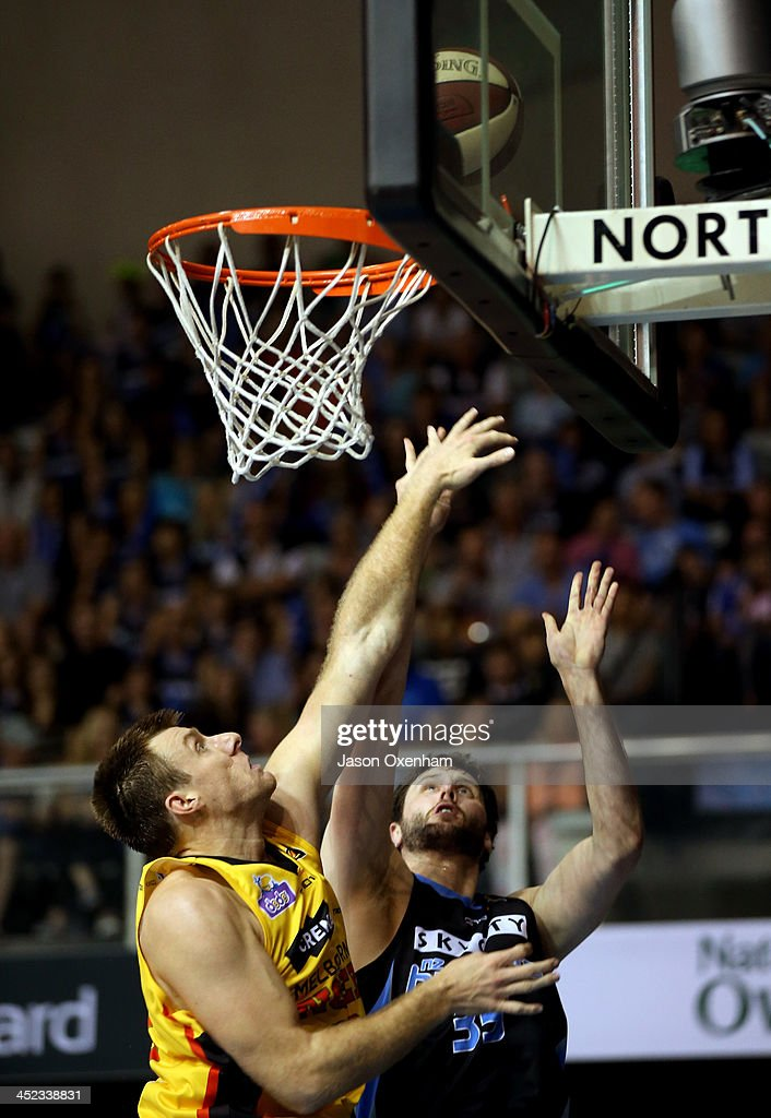 Scott Morrison of the Melbourne Tigers cannot stop Alex Pledger of the Breakers from scoring during the round eight NBL match between the New Zealand Breakers and the Melbourne Tigers at North Shore Events Centre on November 28, 2013 in Auckland, New Zealand.