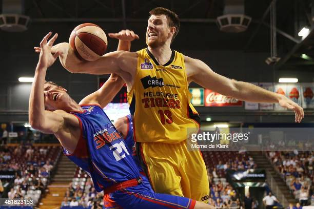 Scott Morrison of the Tigers fouls Daniel Johnson of the 36ers during game three of the NBL Semi Final series between the Adelaide 36ers and the...