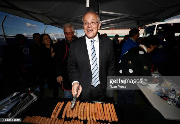 Scott Morrison Prime Minister of Australia cooks sausages during a Liberal Party Campaign Rally at Launceston Airport on April 18 2019 in Launceston...