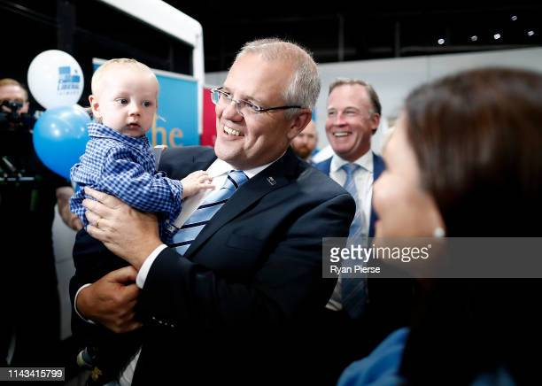 Scott Morrison Prime Minister of Australia holds a baby during a Liberal Party Campaign Rally at Launceston Airport on April 18 2019 in Launceston...