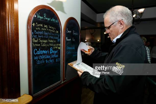 Scott Morrison Prime Minister of Australia orders dinner at Molly Malone's Irish Pub on April 17 2019 in Devonport Australia The 2019 Federal...