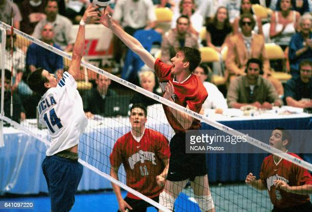 Scott Morrow of UCLA blocks a shot by Colin McMillan of Ohio State University during the Division I Men's Volleyball Championship held at the Allen...