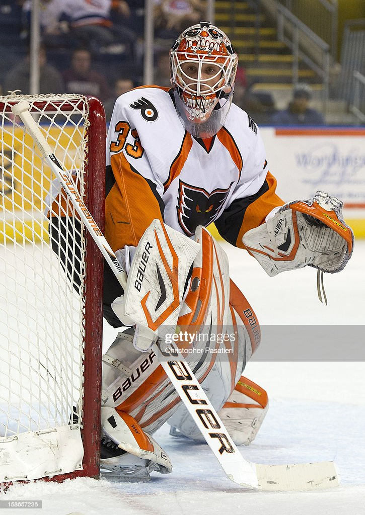 Scott Munroe #33 of the Adirondack Phantoms looks on as he tends goal during an American Hockey League game against the Bridgeport Sound Tigers on December 22, 2012 at the Webster Bank Arena at Harbor Yard in Bridgeport, Connecticut.