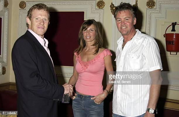 Scott Neeson Paul Young and Stacey Young attend a charity auction and preview screening of the new film '13 Going On 30' on August 5 2004 at the...