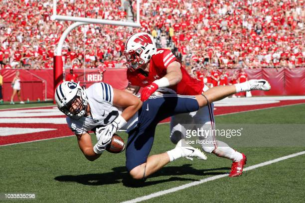 Scott Nelson of the Wisconsin Badgers defends a pass intended for Dallin Holker of the BYU Cougars in the second quarter of the game against at Camp...