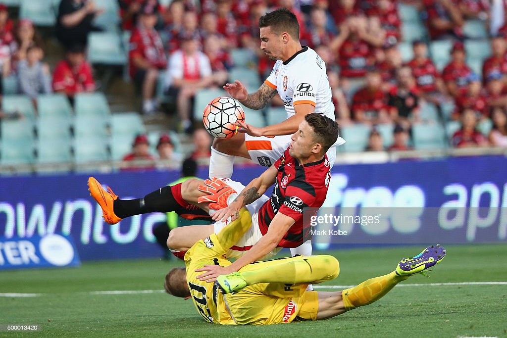 Scott Neville and Andrew Redmayne of the Wanderers tackle Jamie Maclaren of the Roar as he shoots at goal during the round nine A-League match between the Western Sydney Wanderers and the Brisbane Roar at Pirtek Stadium on December 5, 2015 in Sydney, Australia.