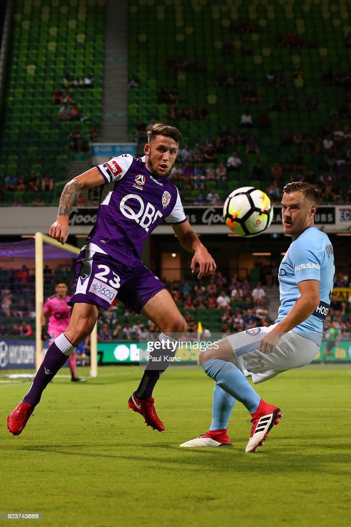 Scott Neville of the Glory and Scott Jamieson of Melbourne contest for the ball during the round 21 A-League match between the Perth Glory and Melbourne City FC at nib Stadium on February 24, 2018 in Perth, Australia.