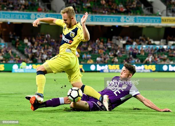 Scott Neville of the Glory attacks the ball against Connor Pain of the Mariners during the round 22 ALeague match between the Perth Glory and the...