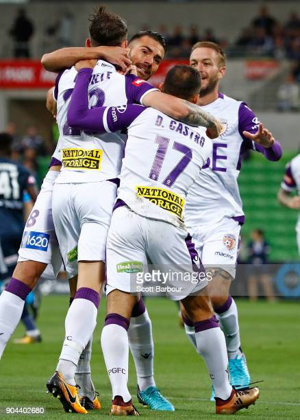 Scott Neville of the Glory celebrates after scoring the first goal with Diego Castro during the round 16 ALeague match between the Melbourne Victory...