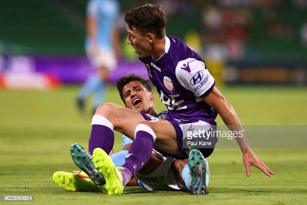 Scott Neville of the Glory tackles Daniel Arzani of Melbourne during the round 15 ALeague match between the Perth Glory and Melbourne City FC at nib...
