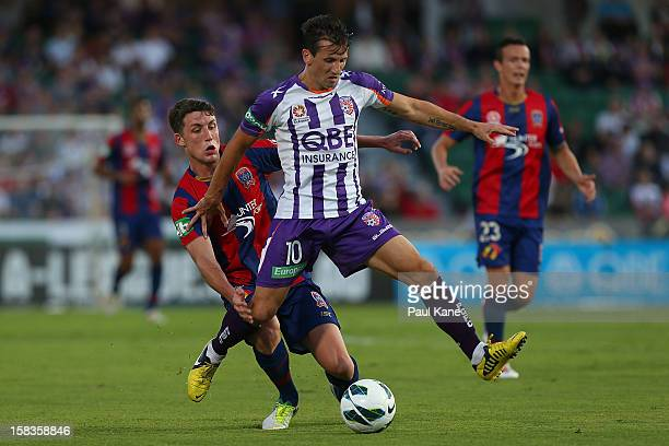Scott Neville of the Jets and Liam Miller of the Glory contest for the ball during the round 11 ALeague match between the Perth Glory and the...