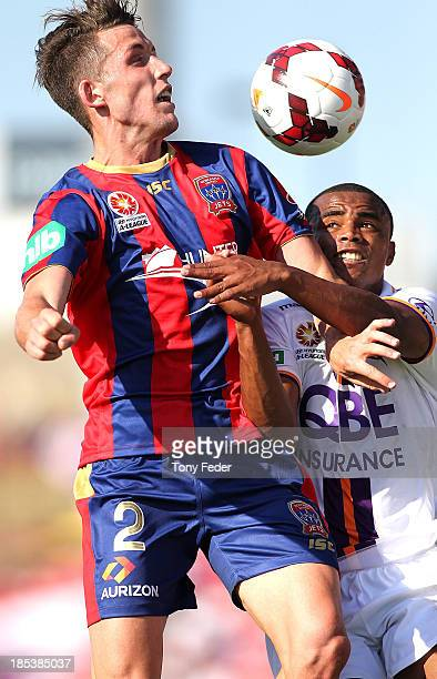 Scott Neville of the Jets headers the ball against Sidnei Sciola Moraes of the Glory during the round two A-League match between the Newcastle Jets...