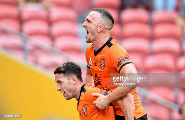 Scott Neville of the Roar celebrates with team mate Thomas Aldred after scoring a goal during the round eight ALeague match between the Brisbane Roar...