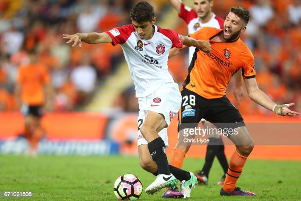 Scott Neville of the Wanderers and Brandon Borello of the Roar compete for the ball during the ALeague Elimination Final match between the Brisbane...