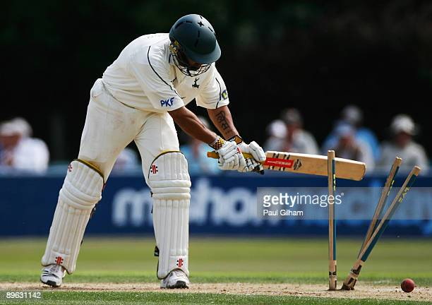 Scott Newman of Nottinghamshire knocks the stumps over in frustration after loosing his wicket to Ollie Rayner of Sussex during day two of the LV...