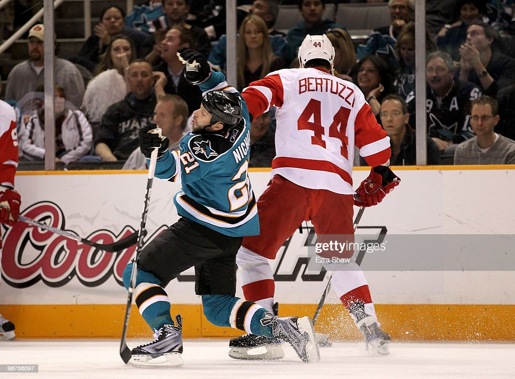 Scott Nichol #21 of the San Jose Sharks is hit by Todd Bertuzzi #44 of the Detroit Red Wings in Game One of the Western Conference Semifinals during the 2010 NHL Stanley Cup Playoffs at HP Pavilion on April 29, 2010 in San Jose, California.