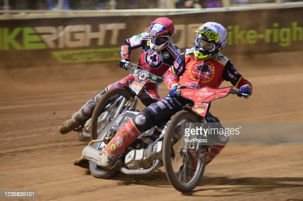 Scott Nicholls leads Steve Worrall during the SGB Premiership Grand Final 1st Leg between Belle Vue Aces and Peterborough Panthers at the National...