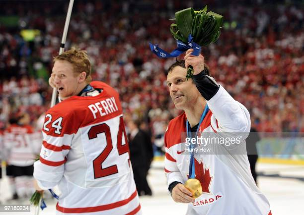 Scott Niedermayer and Corey Perry of Canada celebrate after winning the godl medal in the ice hockey men's gold medal game between USA and Canada on...
