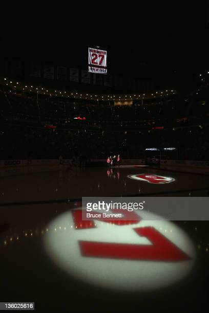 Scott Niedermayer has his jersey lifted to the rafters during his retirement ceremony hosted by the New Jersey Devils prior to the game against the...