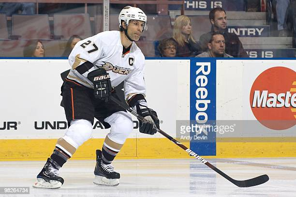 Scott Niedermayer of the Anaheim Ducks concentrates on the puck against the Edmonton Oilers at Rexall Place on March 26 2010 in Edmonton Alberta...