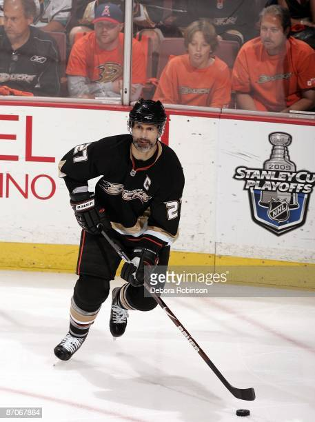 Scott Niedermayer of the Anaheim Ducks handles the puck against the Detroit Red Wings during Game Four of the Western Conference Semifinals Round of...