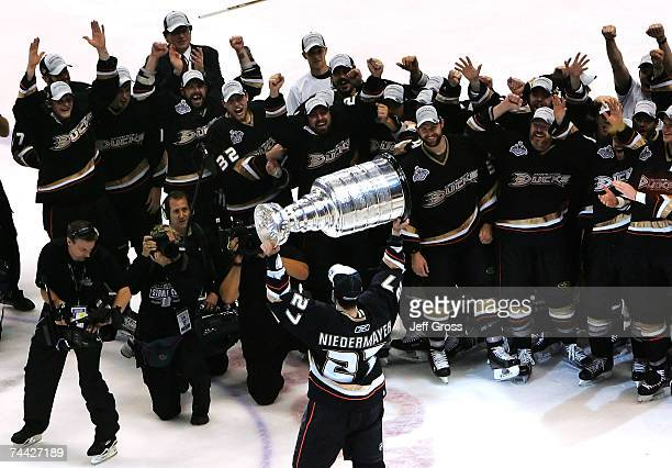 Scott Niedermayer of the Anaheim Ducks lifts the Stanley Cup in celebration with teammates after defeating the Ottawa Senators in Game Five of the...