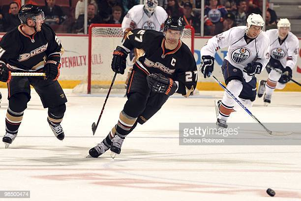 Scott Niedermayer of the Anaheim Ducks races for the puck against the Edmonton Oilers during the game on April 11 2010 at Honda Center in Anaheim...