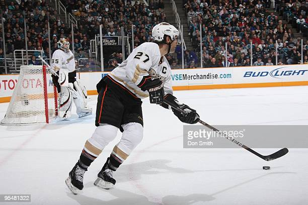 Scott Niedermayer of the Anaheim Ducks skates up ice with the puck during an NHL game against the San Jose Sharks on December 26, 2009 at HP Pavilion...