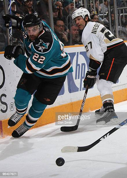 Scott Niedermayer of the Anaheim Ducks watches Dan Boyle of the San Jose Sharks charge after the puck during an NHL game on December 26, 2009 at HP...