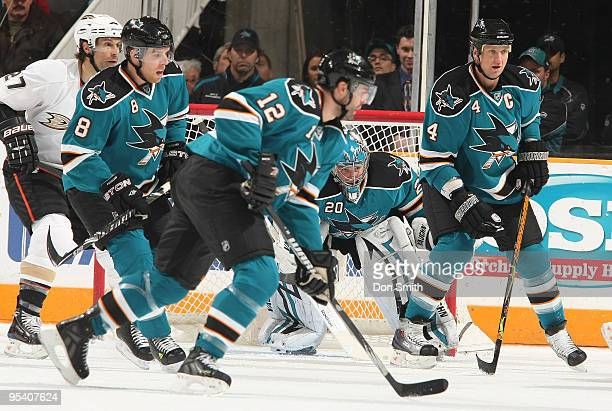 Scott Niedermayer of the Anaheim Ducks watches the puck along with Joe Pavelski, Patrick Marleau, Rob Blake and a crouching Evgeni Nabokov of the San...