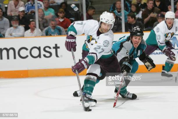 Scott Niedermayer of the Anaheim Mighty Ducks battles for the puck with Scott Hannan during a game against the San Jose Sharks on April 15 2006 at...
