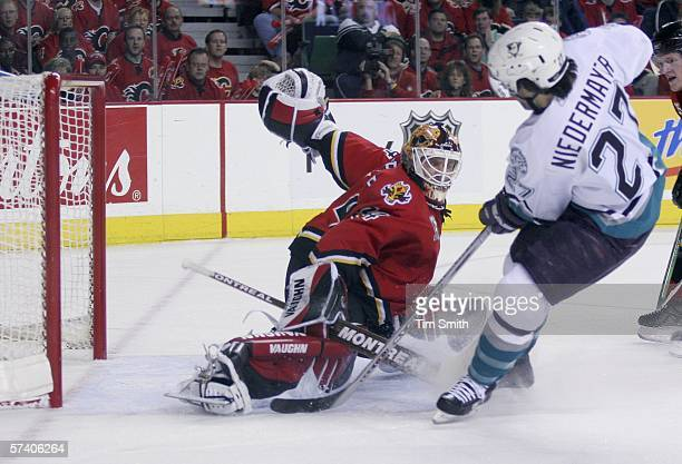 Scott Niedermayer of the Anaheim Mighty Ducks slips the puck past goaltender Miikka Kiprusoff of the Calgary Flames for a goal during first period...
