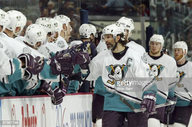 Scott Niedermayer of the Mighty Ducks of Anaheim celebrates with his teammates on the bench after a goal by Todd Marchant in game four of the Western...