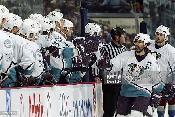 Scott Niedermayer of the Mighty Ducks of Anaheim celebrates with his bench after assisting on a goal by teammate Todd Marchant against the Colorado...