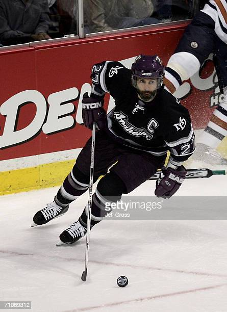 Scott Niedermayer of the Mighty Ducks of Anaheim skates the puck from behind the net during game five of the NHL Western Conference Finals against...
