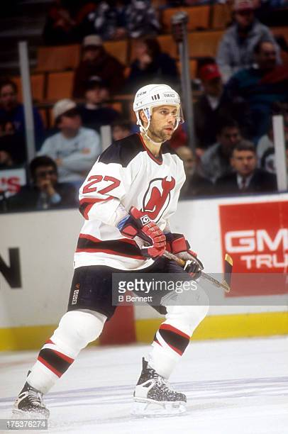 Scott Niedermayer of the New Jersey Devils skates on the ice during an NHL game in December 1995 at the Brendan Byrne Arena in East Rutherford New...