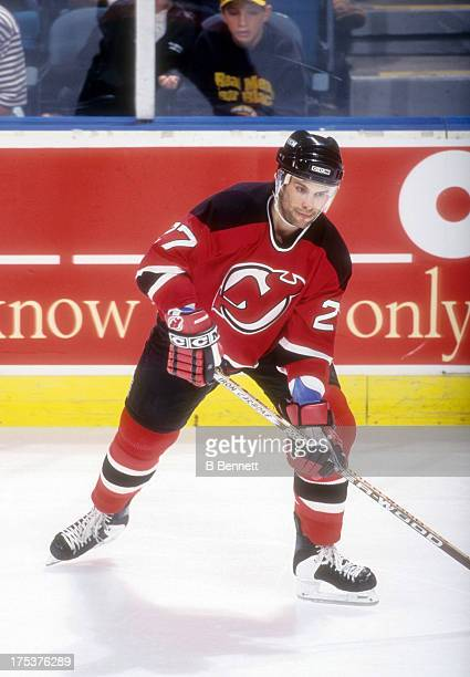 Scott Niedermayer of the New Jersey Devils skates on the ice during an NHL game against the New York Islanders circa 1995 at the Nassau Coliseum in...