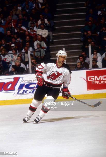 Scott Niedermayer of the New Jersey Devils skates on the ice during an NHL game in March 1996 at the Brendan Byrne Arena in East Rutherford New Jersey