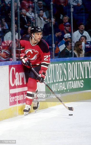 Scott Niedermayer of the New Jersey Devils skates with the puck during an NHL game against the New York Islanders circa 1995 at the Nassau Coliseum...