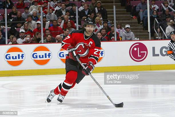 Scott Niedermayer of the New Jersey Devils skates with the puck against the Philadelphia Flyers in game four of the Eastern Conference Quarterfinals...